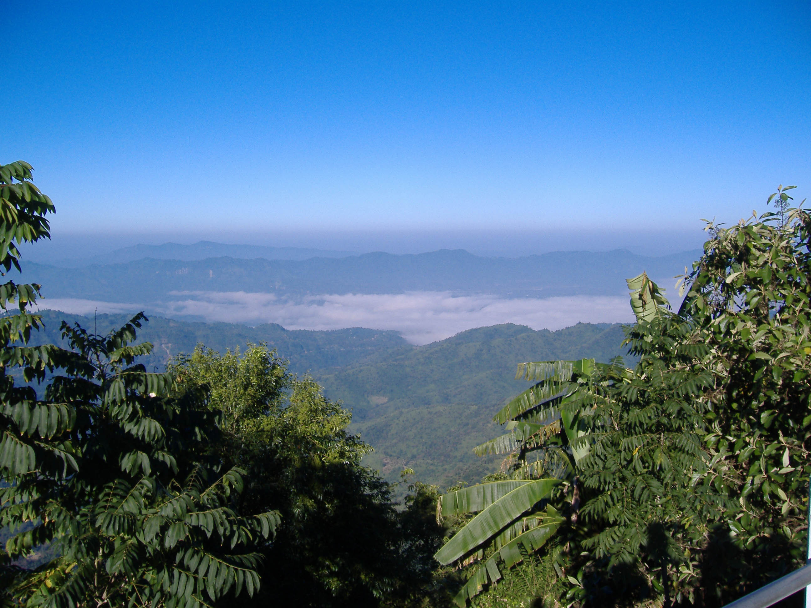 View west from Aizawl: Aizawl Anticline, Sairang Syncline in cloud, Tuanzawal Anticline
